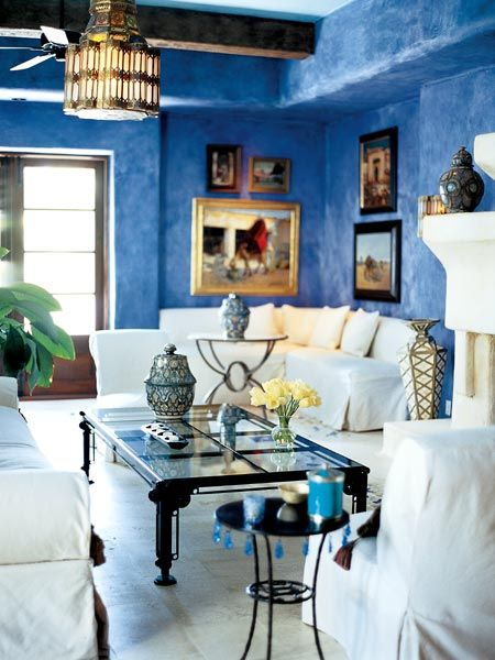 Mediterranean Inspired Living Room With Blue Walls And White Furniture From Sothern Accents
