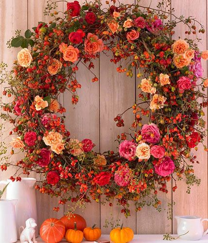 Photo of Autumn wreath of apple roses, dog roses and tufted roses