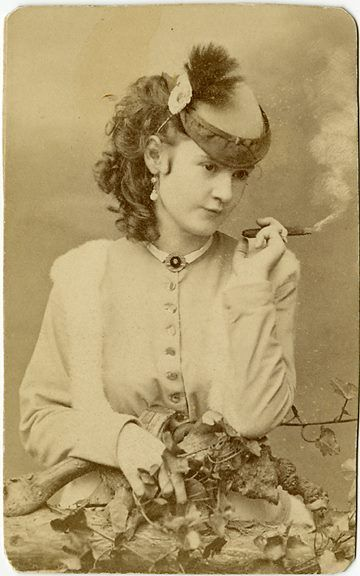An original photo bought in San Franciso about 15 years ago. It's a classic image of Lotta Crabtree smoking a cigar. She was a major singer-actress in the 1880s earning up to 5K a week and when she died in 1924 she left an estate worth 4 million. She donated a fountain to San Fran at Market & Kearny where people meet to mark the anniversary of the 1906 earthquake.