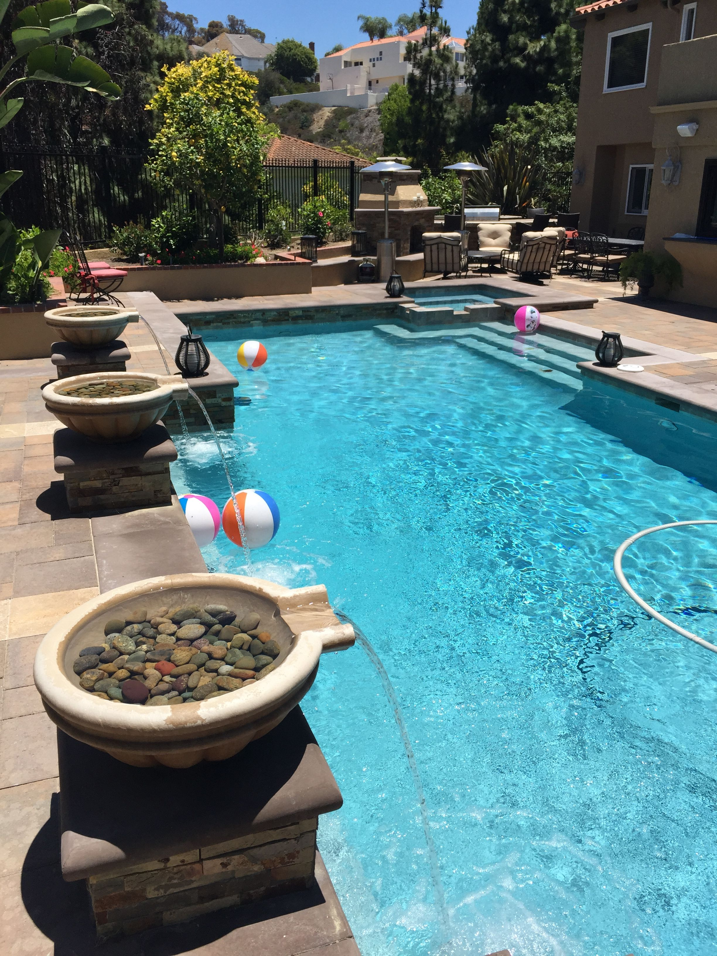 Remodeled Pebble Tech Pool Pavers With Integrated Spa Added Stacked Stone Cement Coping Built In Table Wit Pool Fountain Backyard Pool Designs Backyard Pool