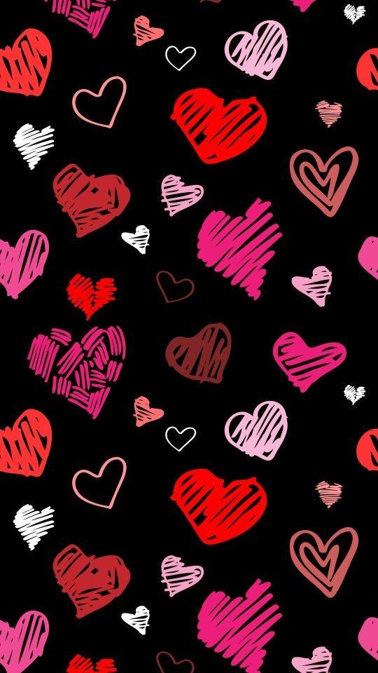 Fondo de pantalla negro con corazones