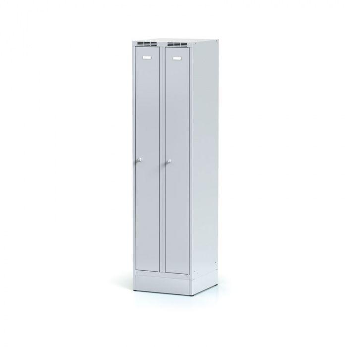 Metal wardrobe narrowed on the plinth, gray door, cylindrical …