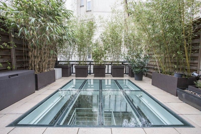 Loft avec toit-terrasse en verre à Paris Avec, En and Toit - maison avec toit en verre