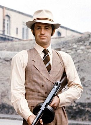 JEAN-PAUL BELMONDO  A Macho-ne gun (Thompson 45) + White Borsalino. Still  from  Borsalino  (1970) fcec4e72c021
