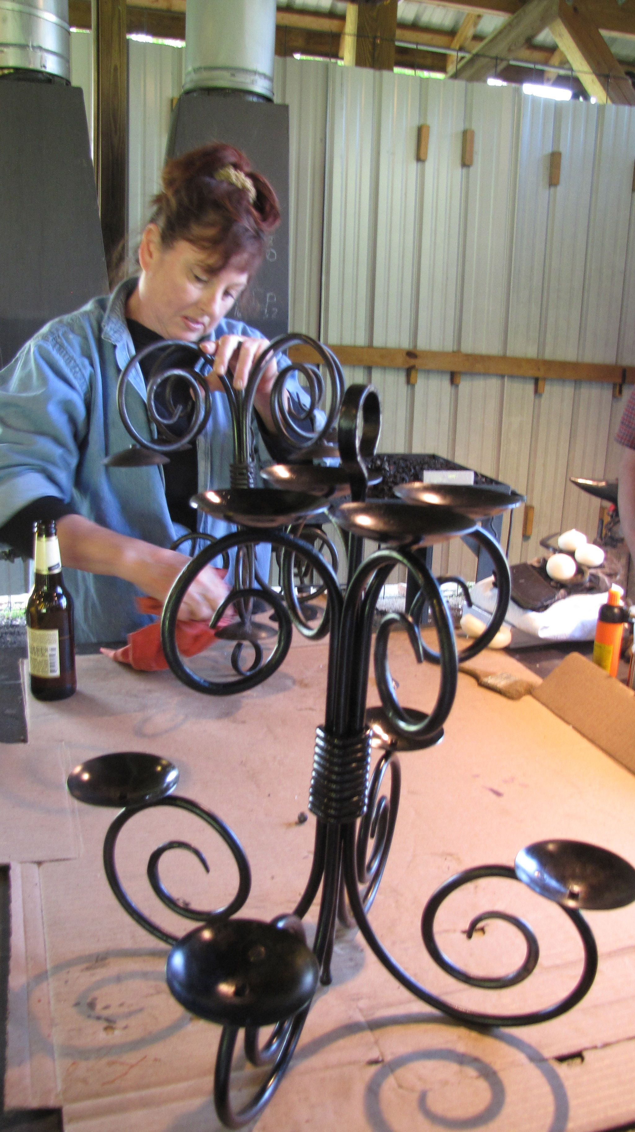 Beginning blacksmithing candelabra project for Craft in america forge