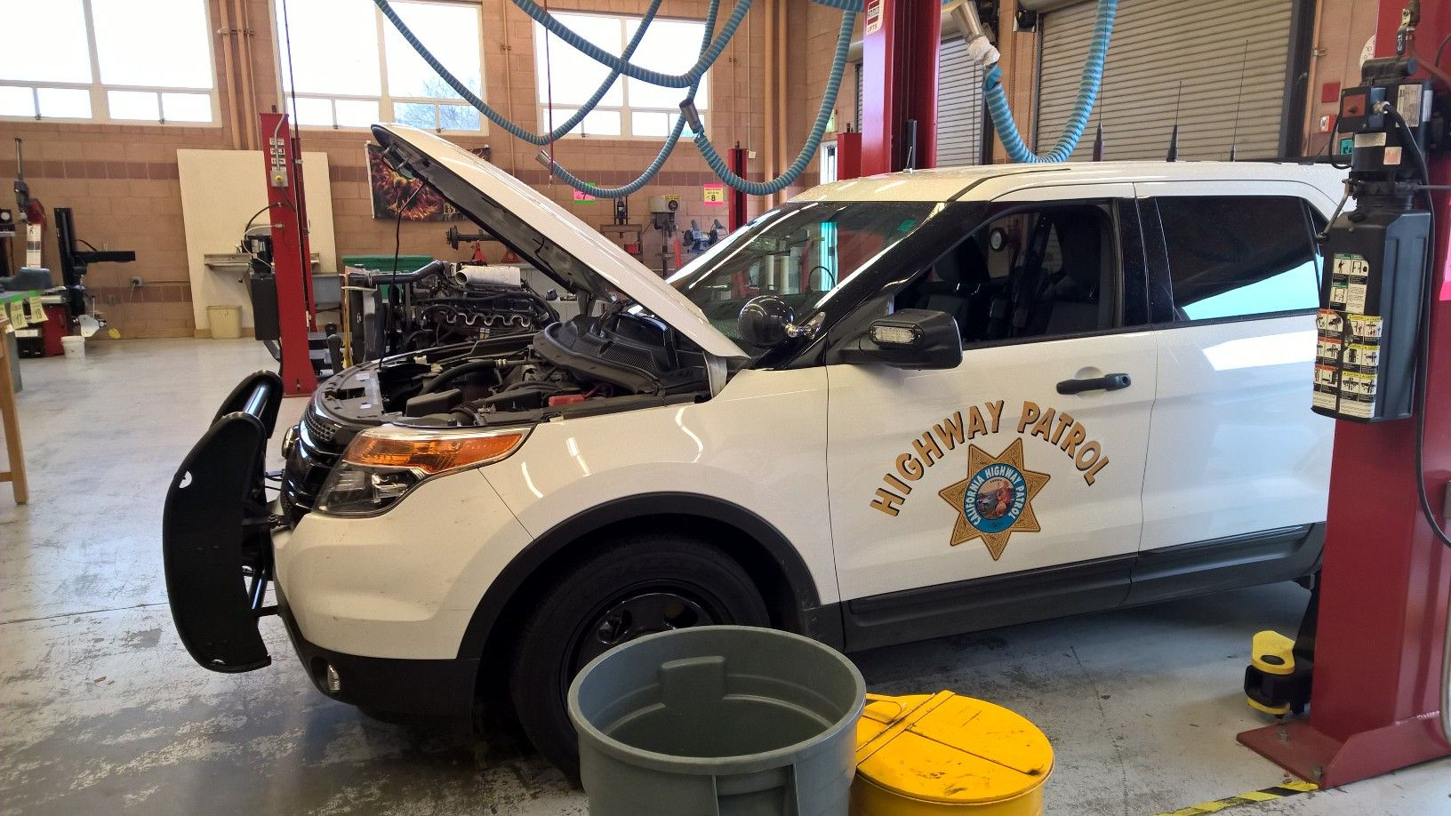 Chp Explorer In The Garage For Repair California Highway Patrol Police Cars Police Uniforms