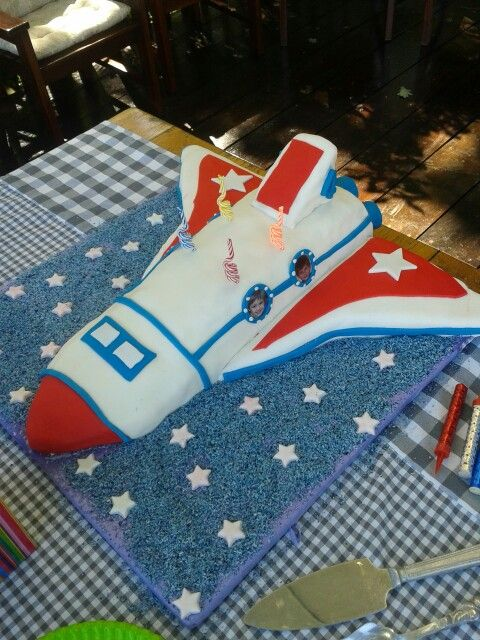 Our space shuttle at last after browsing through a lot of ideas. 4 boys party with their photos on the side. Was a winner!