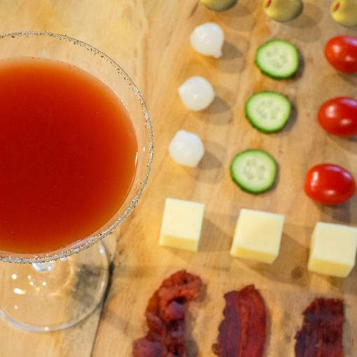 BLOODY MARTINI 2 parts Three Olives® Vodka 2 parts spicy tomato juice Lemon juice and Worcestershire sauce to taste Garnish with Dad's favorites