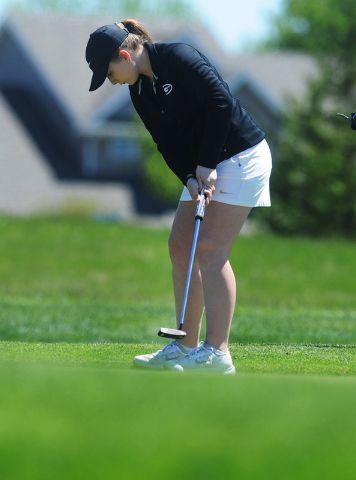 Gilbert's Katie Jenkins strikes a putt at the Heart of Iowa Conference meet on Wednesday at Cedar Point Golf Course. Photo by Nirmalendu Majumdar/Ames Tribune  http://amestrib.com/sports/girls-golf-gilbert-wins-hoic-scoring-error