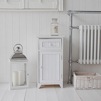 A Crisp White Freestanding Bathroom Storage Furniture. A Narrow Bathroom  Cabinet With One Drawer And A Cupboard, Each With A White Wooden Knob And  Tongue ...