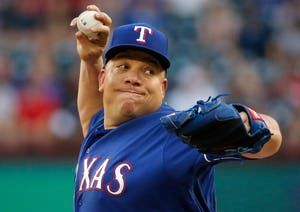 Bartolo Colon pitchers in the 1st May 21 against the Yankees. (Louis DeLuca/The Dallas Morning News)