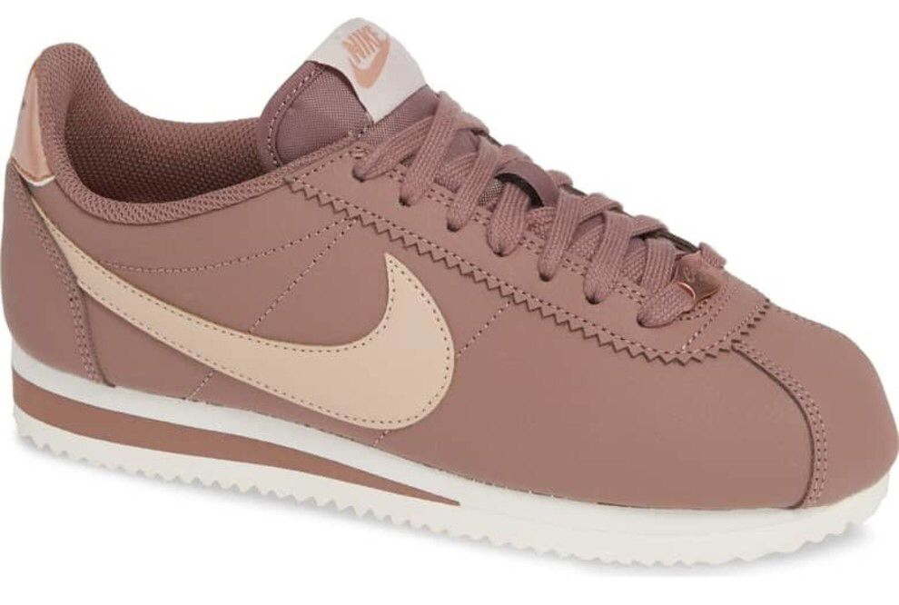 b327f16da67 A pair of classic Nike Cortez sneakers with all the details in pink — these  are