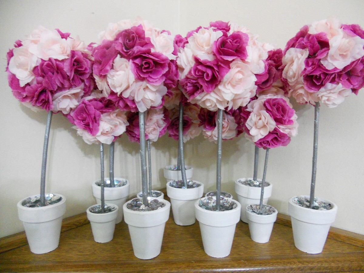 Imagen de http://consejosgratis.com/wp-content/uploads/2015/05/topiarios-con-flores-souvenir-centro-de-mesa-hermosos-13638-MLA3247409591_102012-F.jpg.