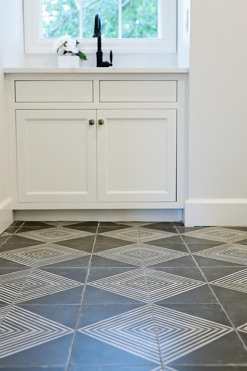 Beautiful Gray And White Laundry Room Features White And Gray Diamond Pattern Floor Tiles Leading Laundry Room Tile Laundry Room Flooring Patterned Floor Tiles