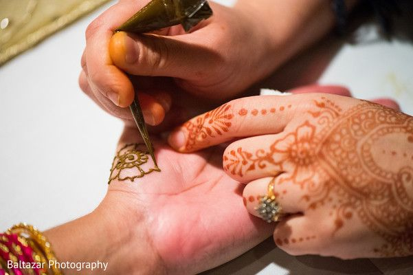 A bride and groom celebrate at their pre-wedding festivities.