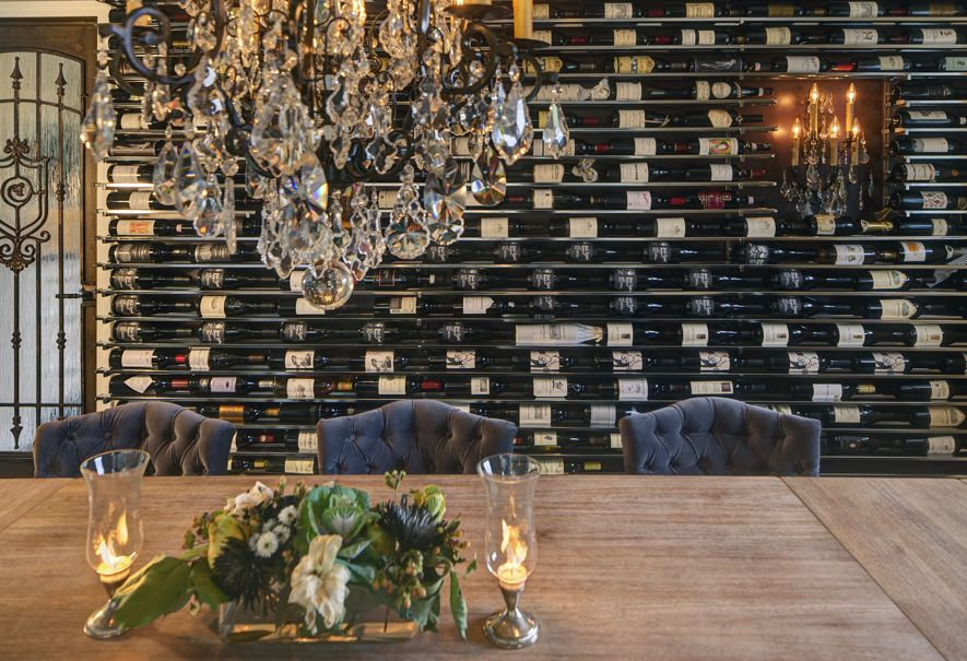 Elegant custom metal wine rack and tasting room.