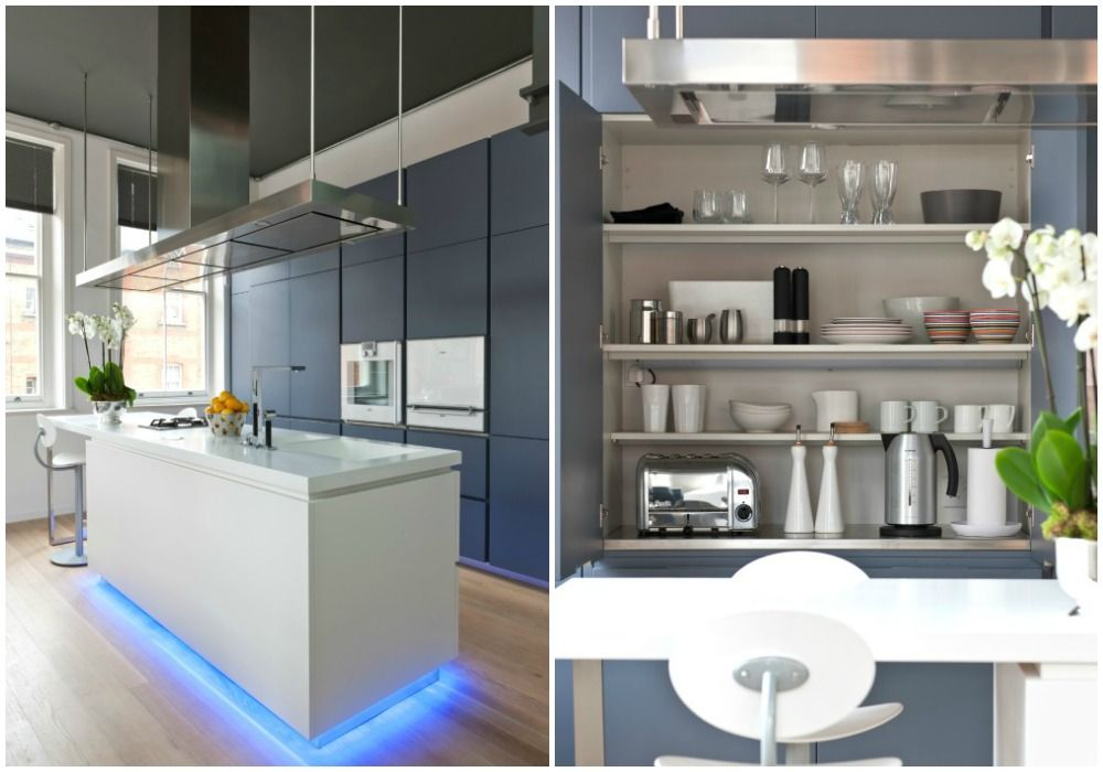 The Poliform kitchen has white Corian surfaces, a floating island - contemporary kitchen hoods