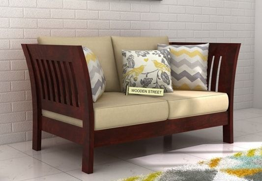 Buy Raiden 2 Seater Wooden Sofa Online In Mahogany Finish To Get An Awesome Furniture Unit Which Provides Comfy Sea Wooden Sofa Designs Wooden Sofa Sofa Design