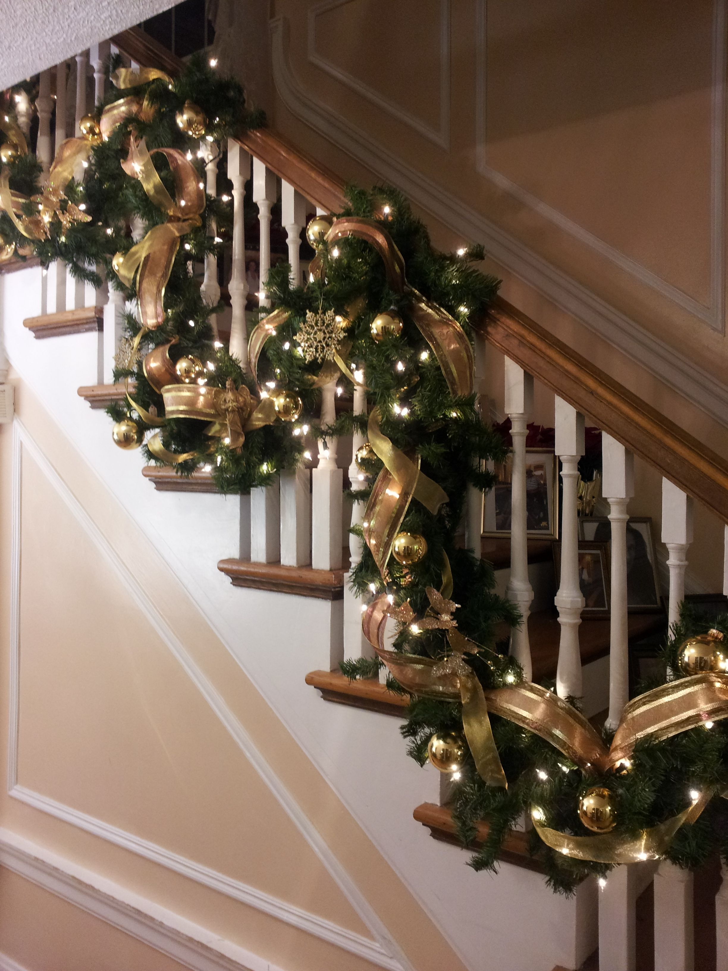 christmas garland banister maybe do the red plaid bows as well christmas stairs christmas tree