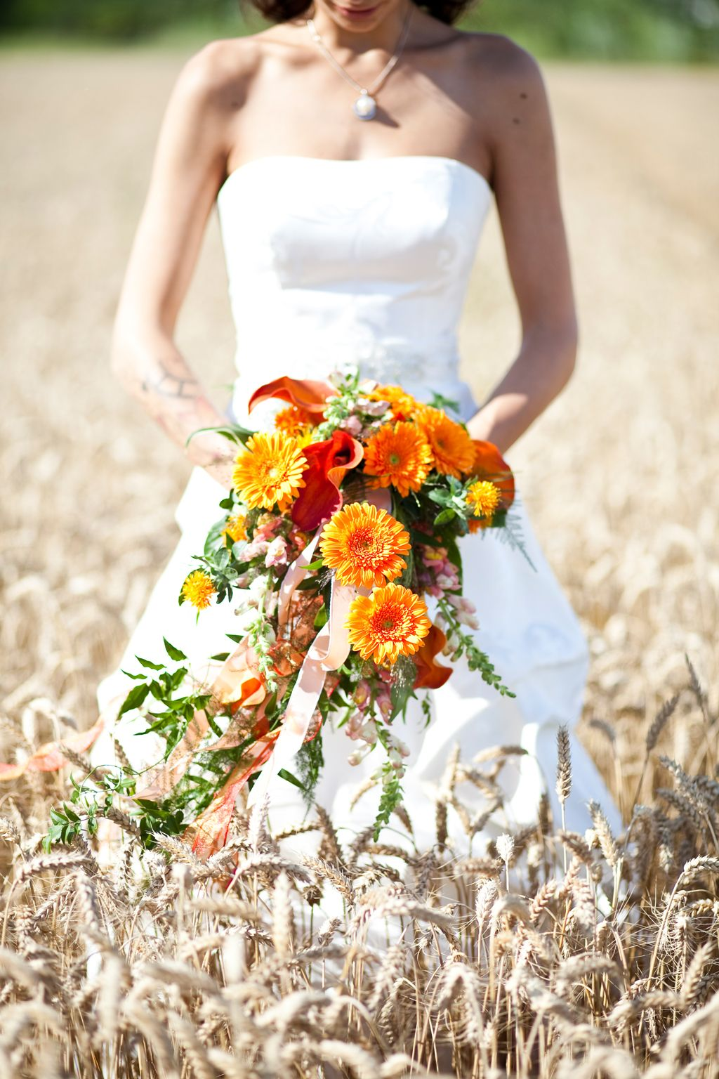 summer bouquet with bride in a cornfield