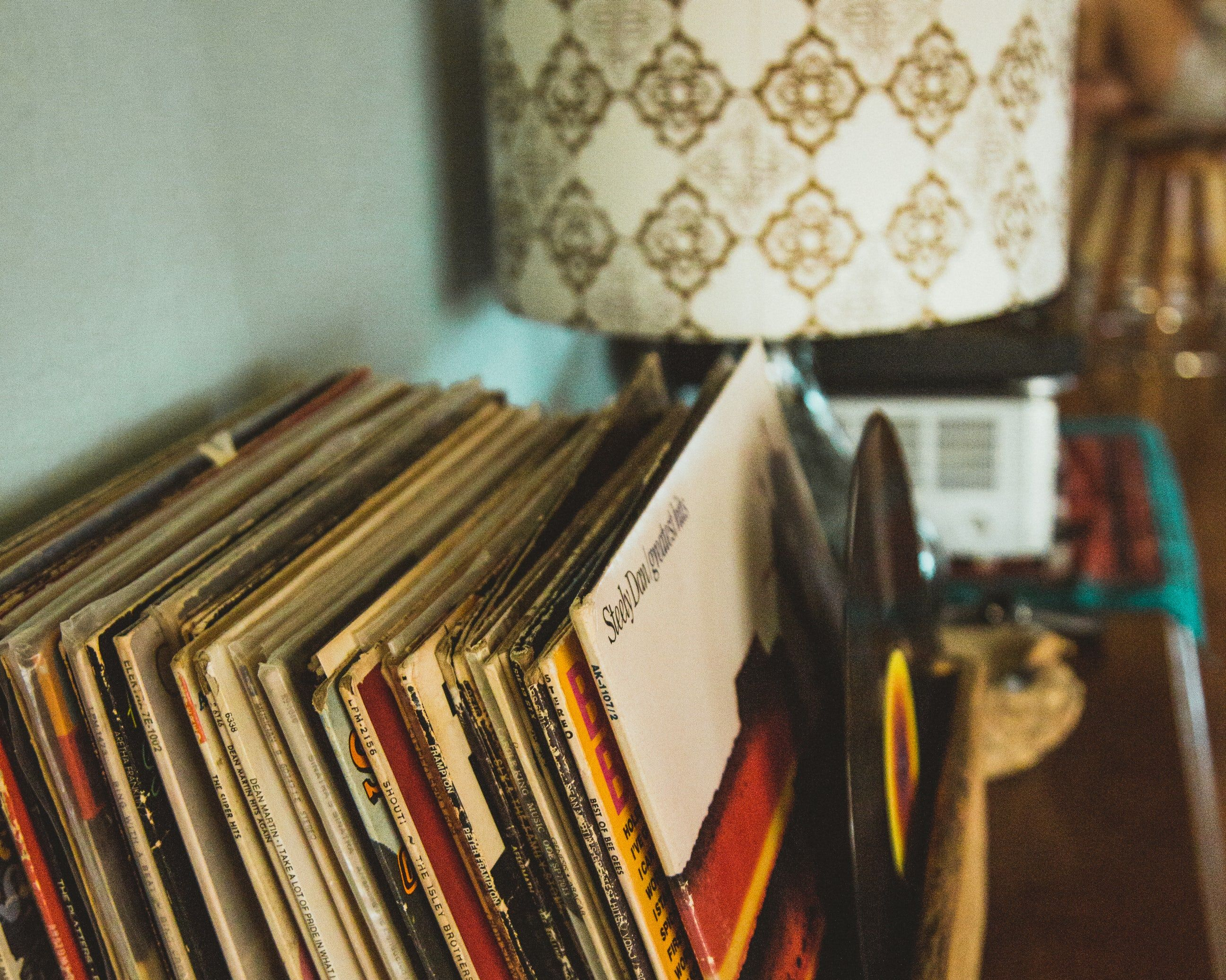 A collection of vintage records and a retro lamp Retro