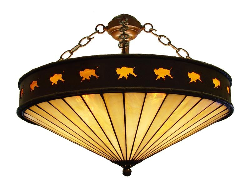 wildwestdesigns.com  Peter M. Fillerup  Buffalo Silhouette Chandelier  A warm glowbrings the running buffalo to life in this steel and caramel glass ceiling light.    Dimensions: 18″, 24″, 30″ or 36″ diameter  Item #: CH 1165