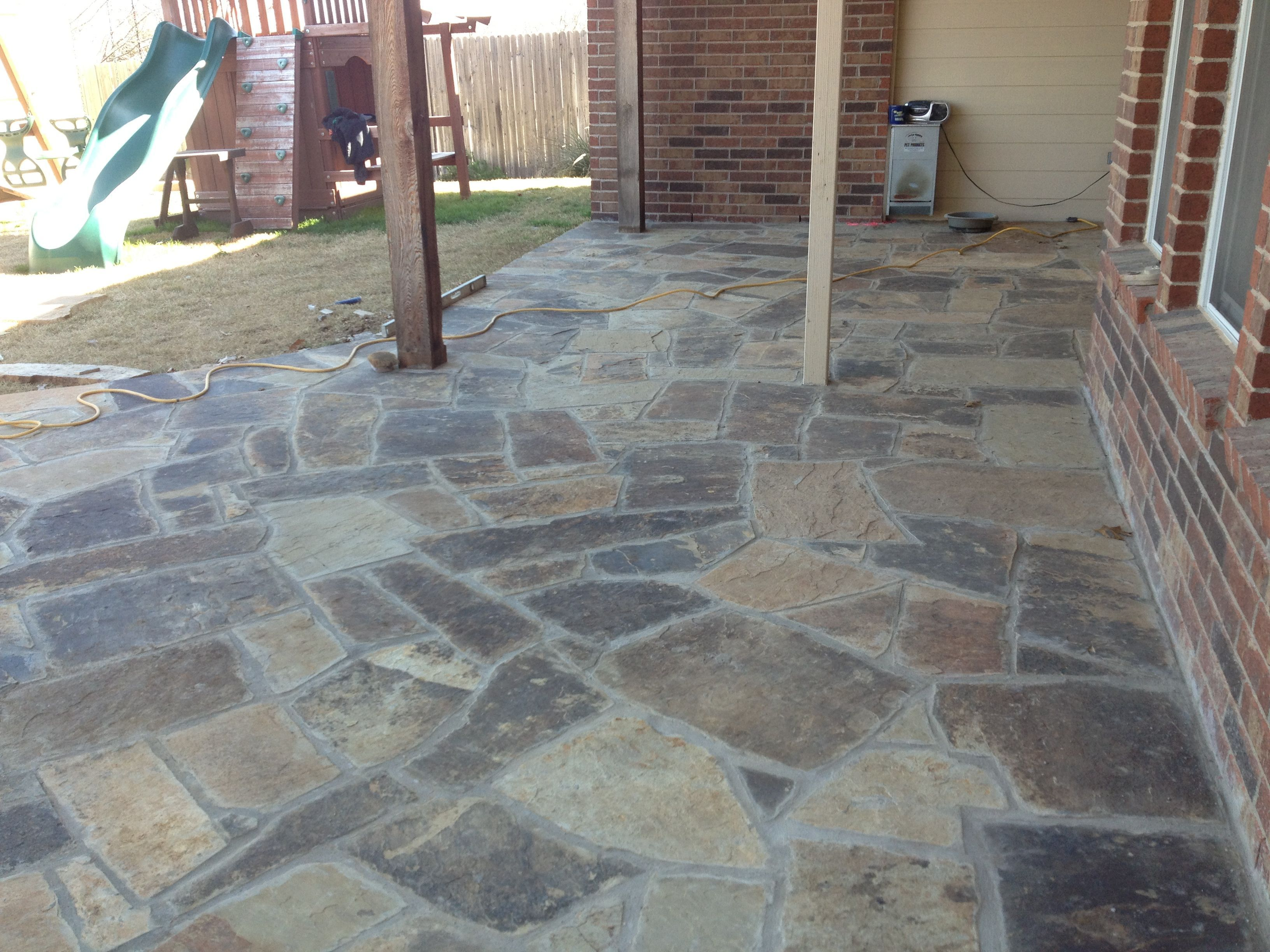 GroundScape, A Fort Worth Landscape Company, Installs A Flagstone Patio Off  The Back Of