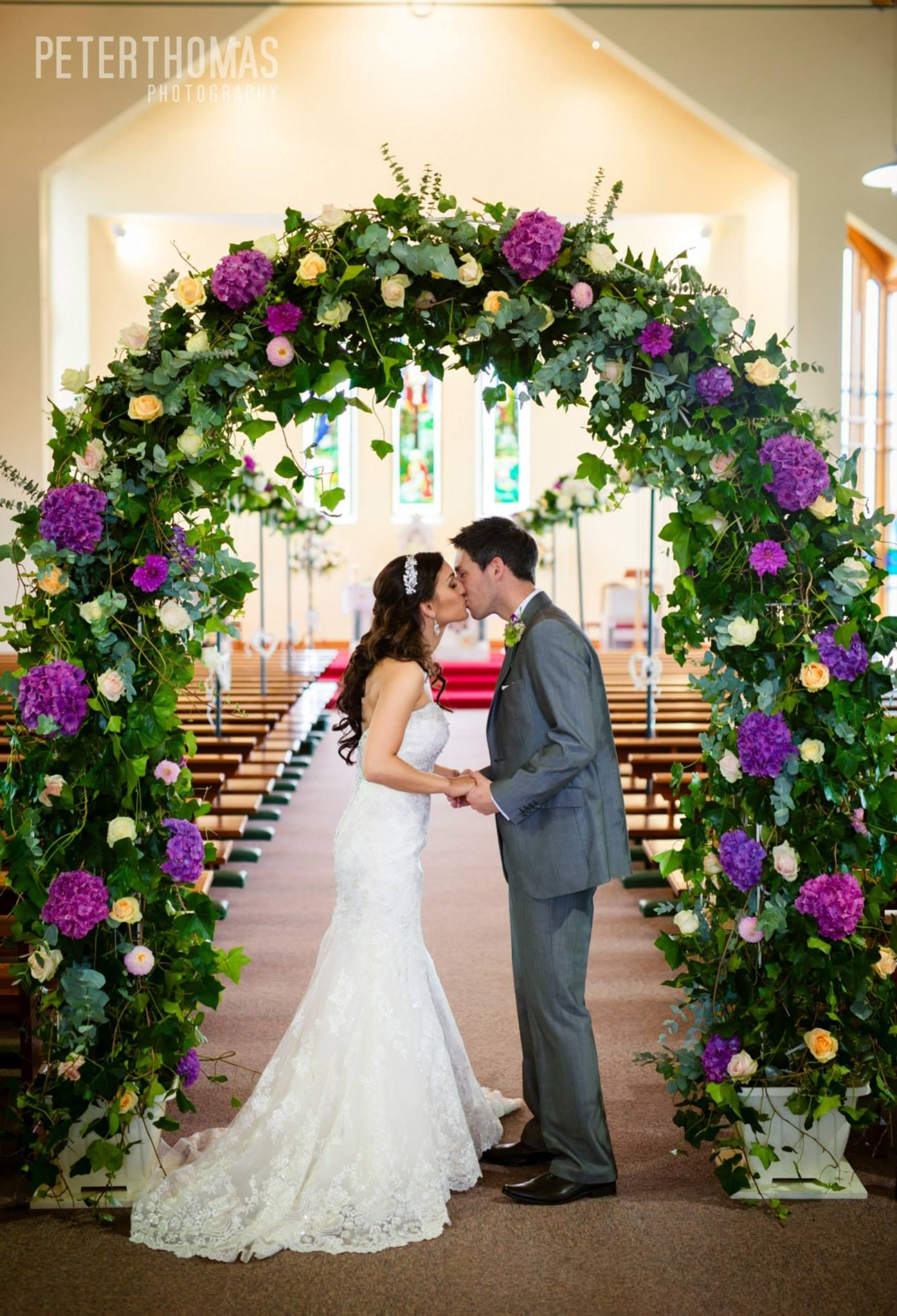 Arch with fresh Flowers and Foliage Wedding arrangements