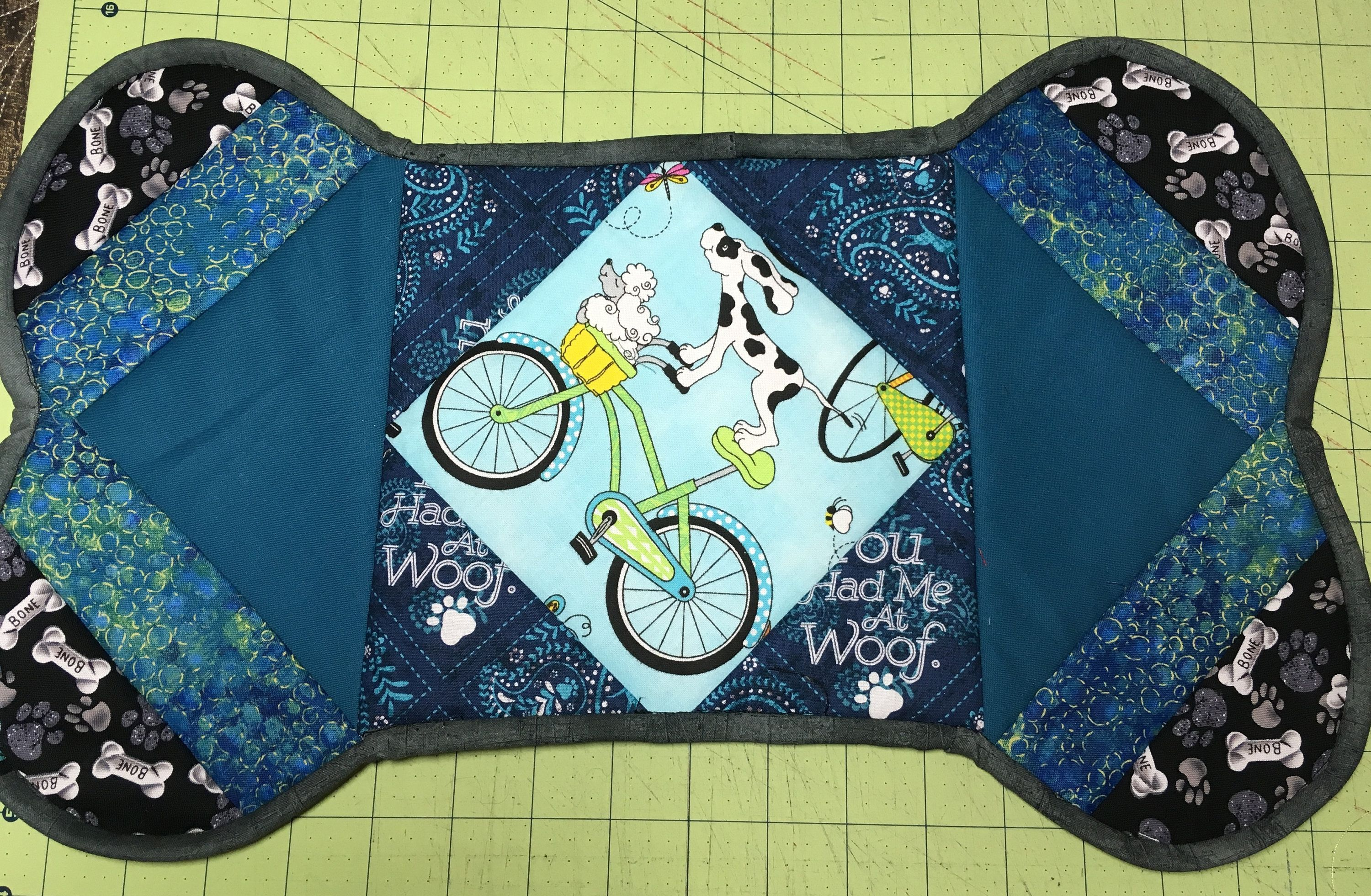 Custom quilted dog bone mat for food and water bowlspet