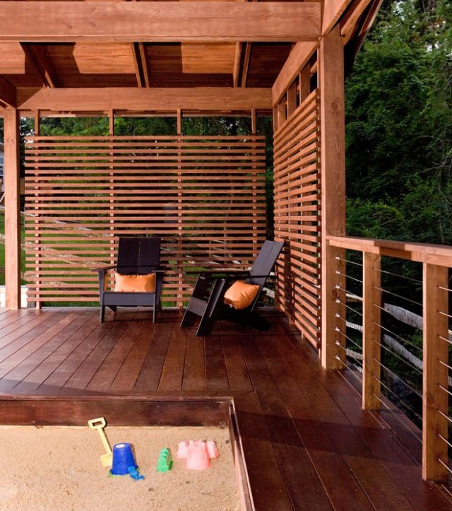 Pretty deck railing privacy fence a porch is a porch for Outdoor deck privacy ideas