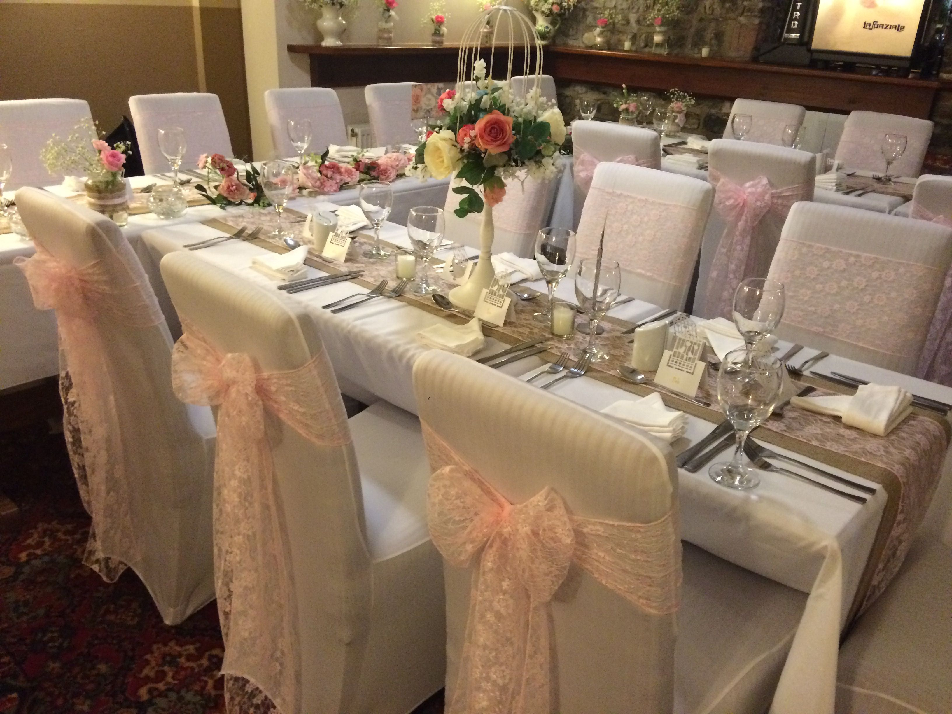 White Chair Covers And Pink Lace Sashes And Hessian Table Runners At A South Wales Wedding Dressed By Www Affinityevent Wedding Wedding Hire White Chair Covers