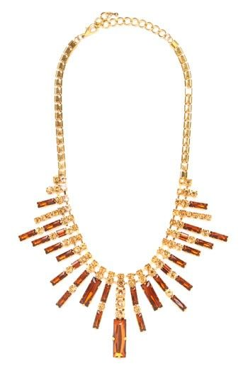 "The Art Deco trend rears its glamorous head again! Just check out this stunning statement necklace, which works a Jazz Age vibe with that graphic sunburst pattern crafted from sparkling gemstone ""rays."""