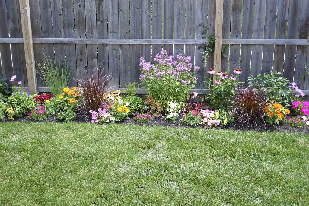 flower garden along fence fences gardens and garden ideas