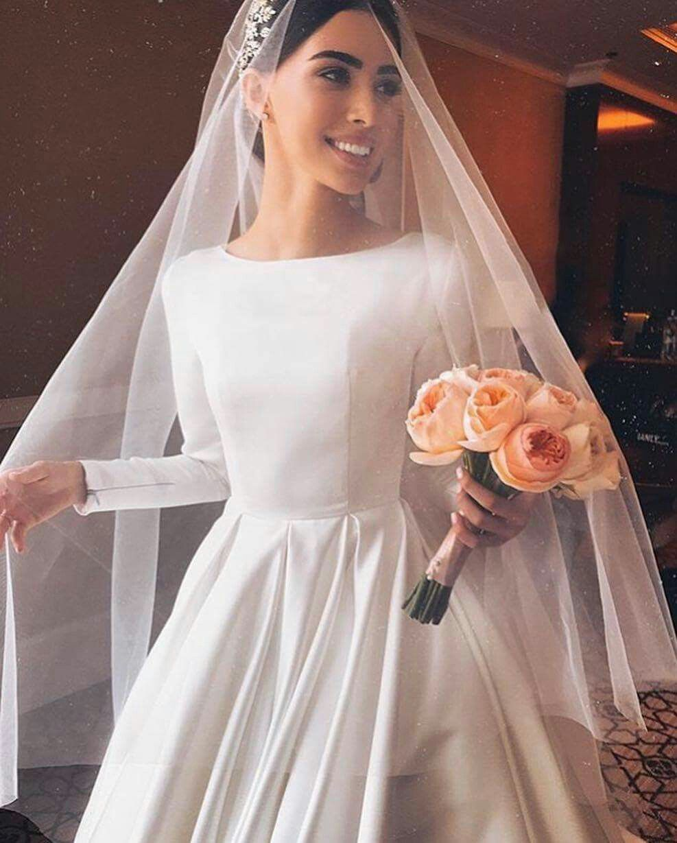 A Beautiful Bride Wearing A Simple But Elegant Wedding Gown With Long Sleeves Wedding Dress Long Sleeve Wedding Dresses Simple Long Wedding Dresses