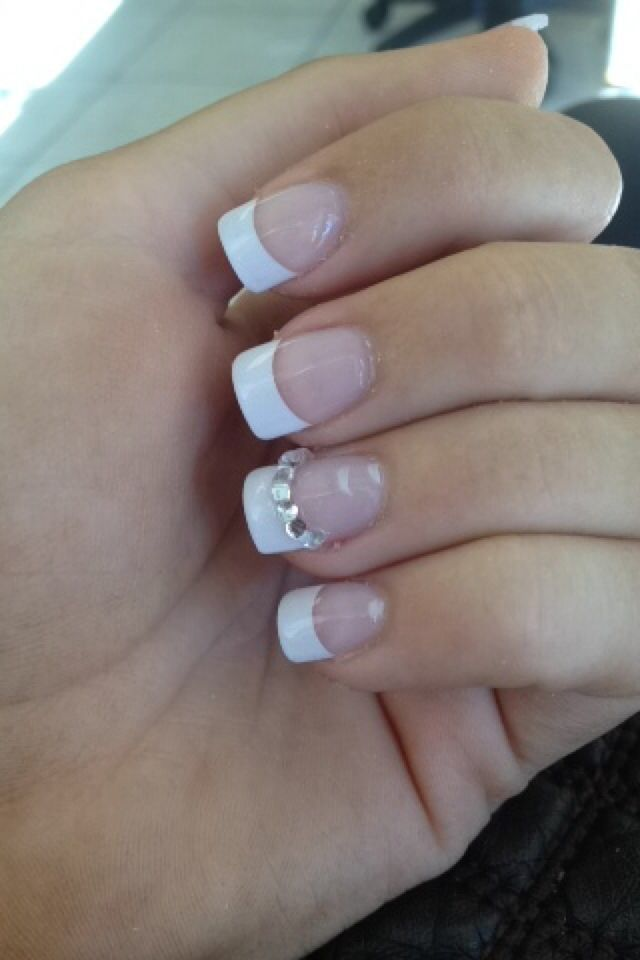 Plain and simple acrylic French tip nails manicure for prom with rhinestone detail