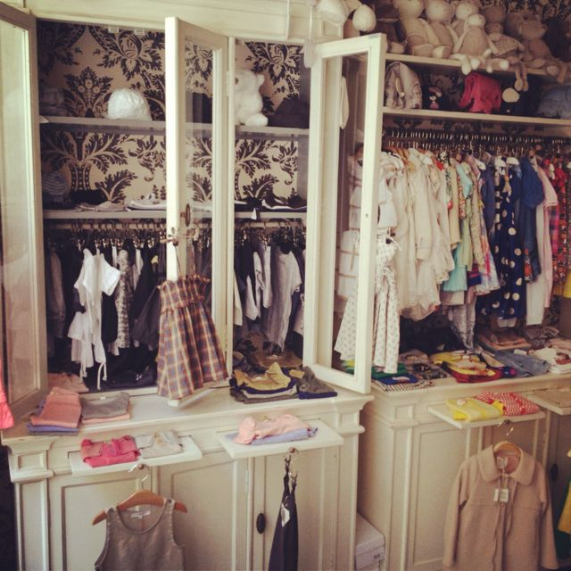 Children boutique in Paris....super cute!!! Love the armoirs for ...