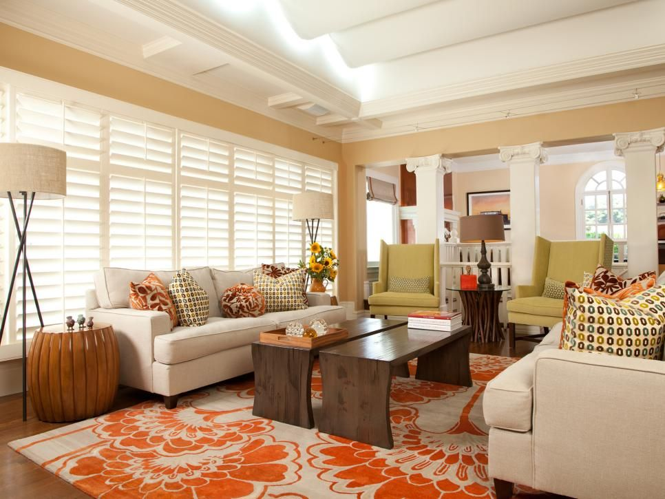 orange and cream living room a lively orange and rug with a camellia motif warms 22985