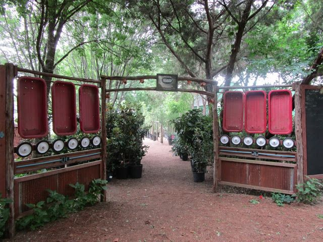 Gateway At The Natural Gardener Nursery Austin Texas Incorporates Little Red Wagons That Have Done Their Customer Service