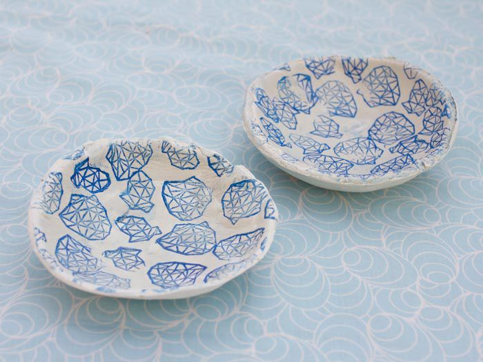 How to make small bowls from modelling clay with decorative prints on them.