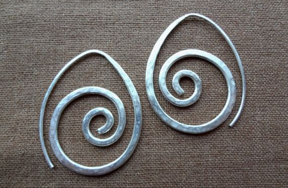 Sterling silver hand-hammered swirling spiral shape earring. The front of these…
