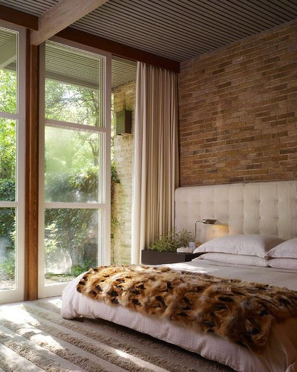 Exposed brick and long drapes with a touch of fur.  Beautiful! Daily Crush