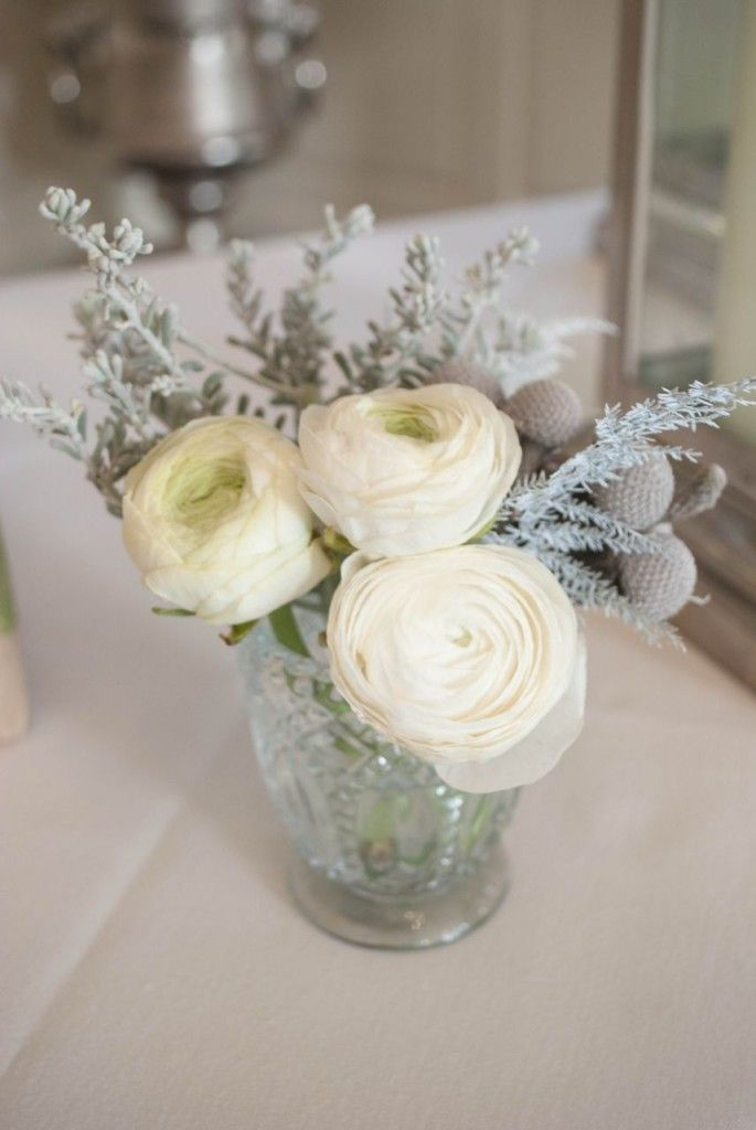 Winter wedding flowers small glass votive with white