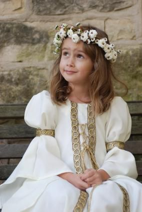 cute little girl in medieval costume with flower wreath
