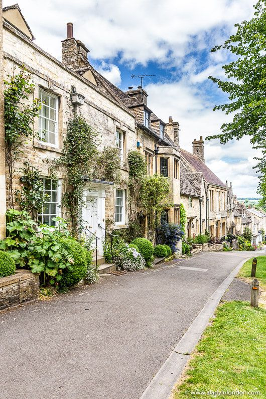 A pretty street in the village of Burford in the Cotswolds, England. This is one of the most beautiful places in England. Click through for more pictures on the A Lady in London blog.   #cotswolds #england #village #burford