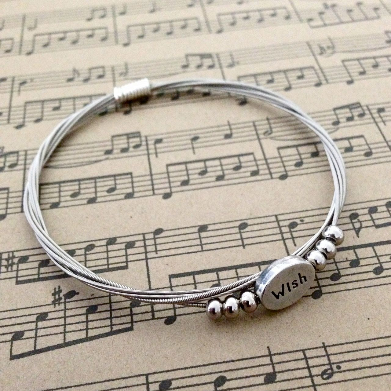 Recycled guitar string jewelry - Recycled Guitar String Bangle