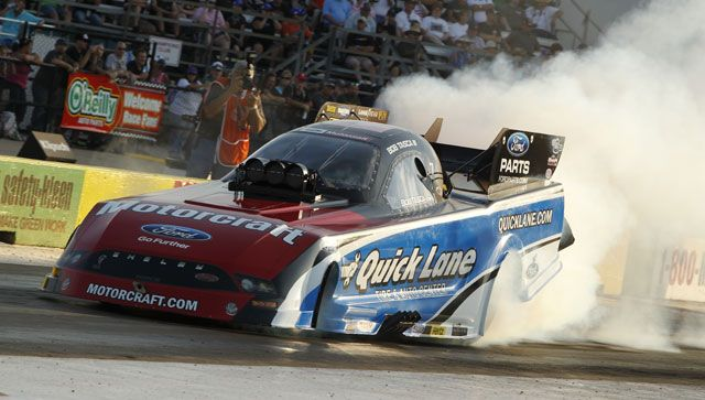 Bob Tasca Iii Warms Up The Tires Of The Quick Lane Funny Car With