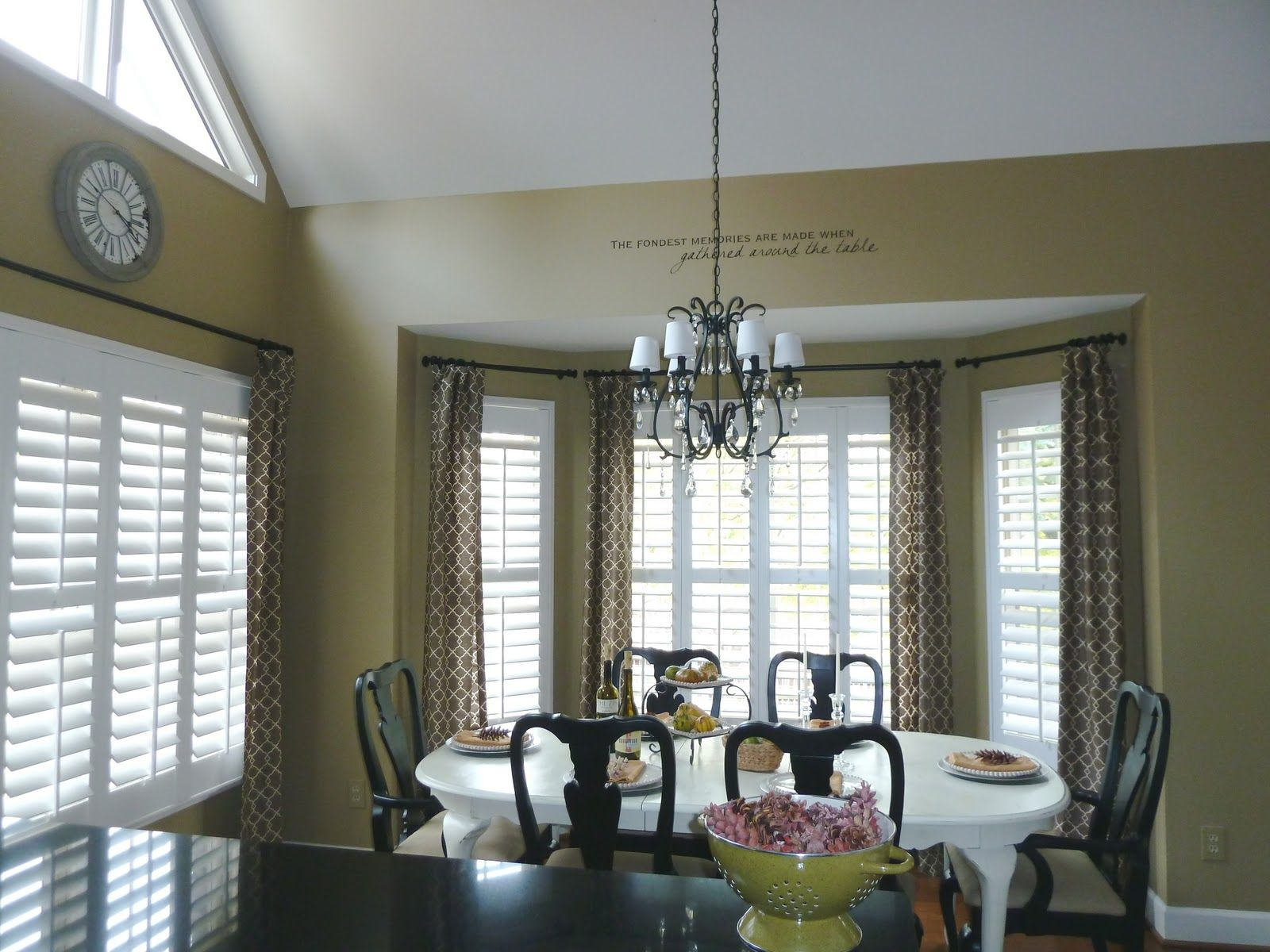 Bay window with plantation shutters and curtains for Window treatments for bay windows in dining room
