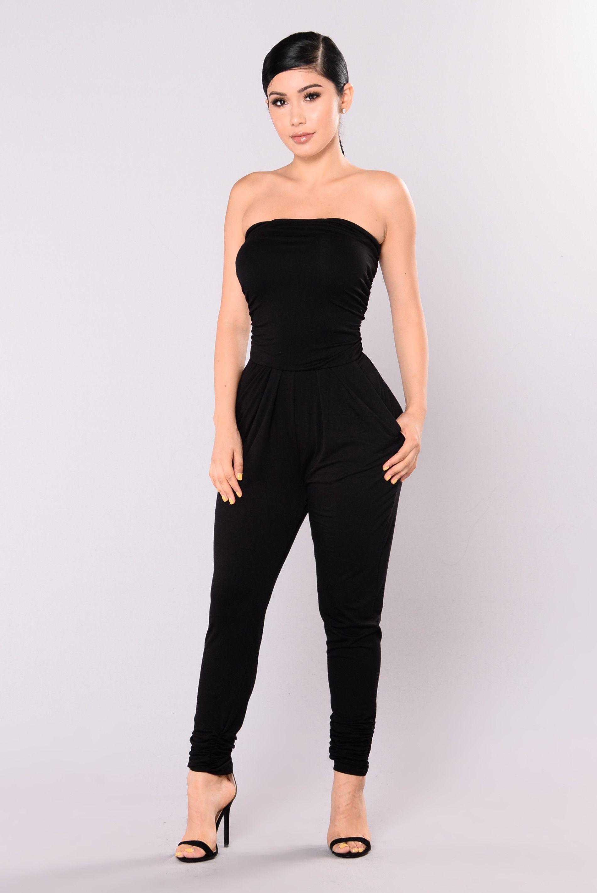 5dbd1f9014 Available In Black Tube Jumpsuit Draped Top Skinny Leg 97% Rayon