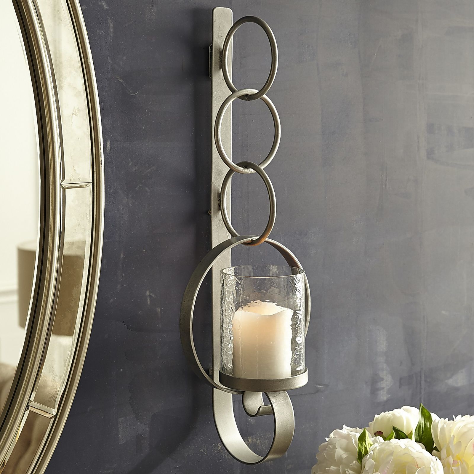 Our Silver Toned Wall Sconce Is The Missing Link In Your Interior Decor Stacked Rings Give The Impressi Candle Wall Sconces Wall Candles Silver Candle Sconces