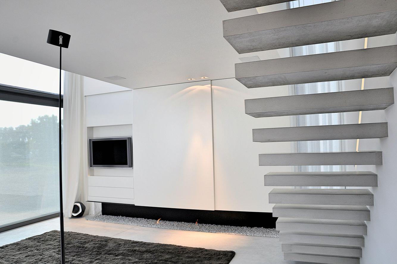 Open gashaard ontwerp zwevende trap met beton treden architect